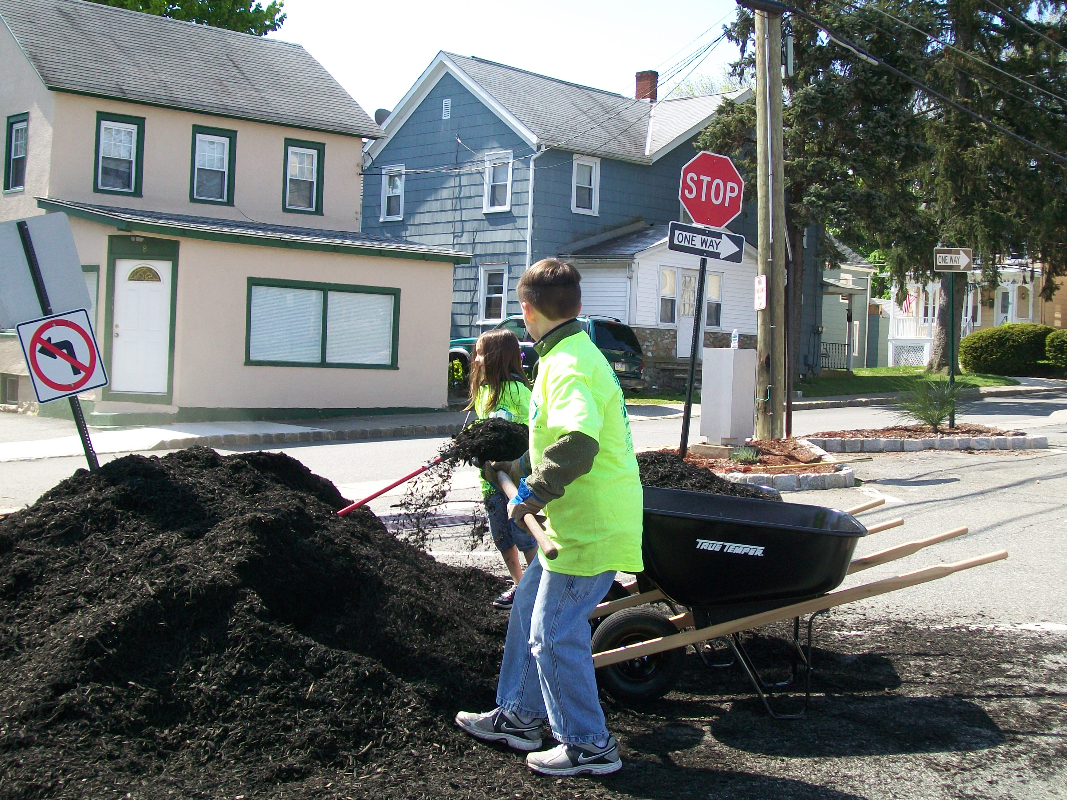 Some young volunteers spreading mulch in Lot #1 - Adams Street Lot