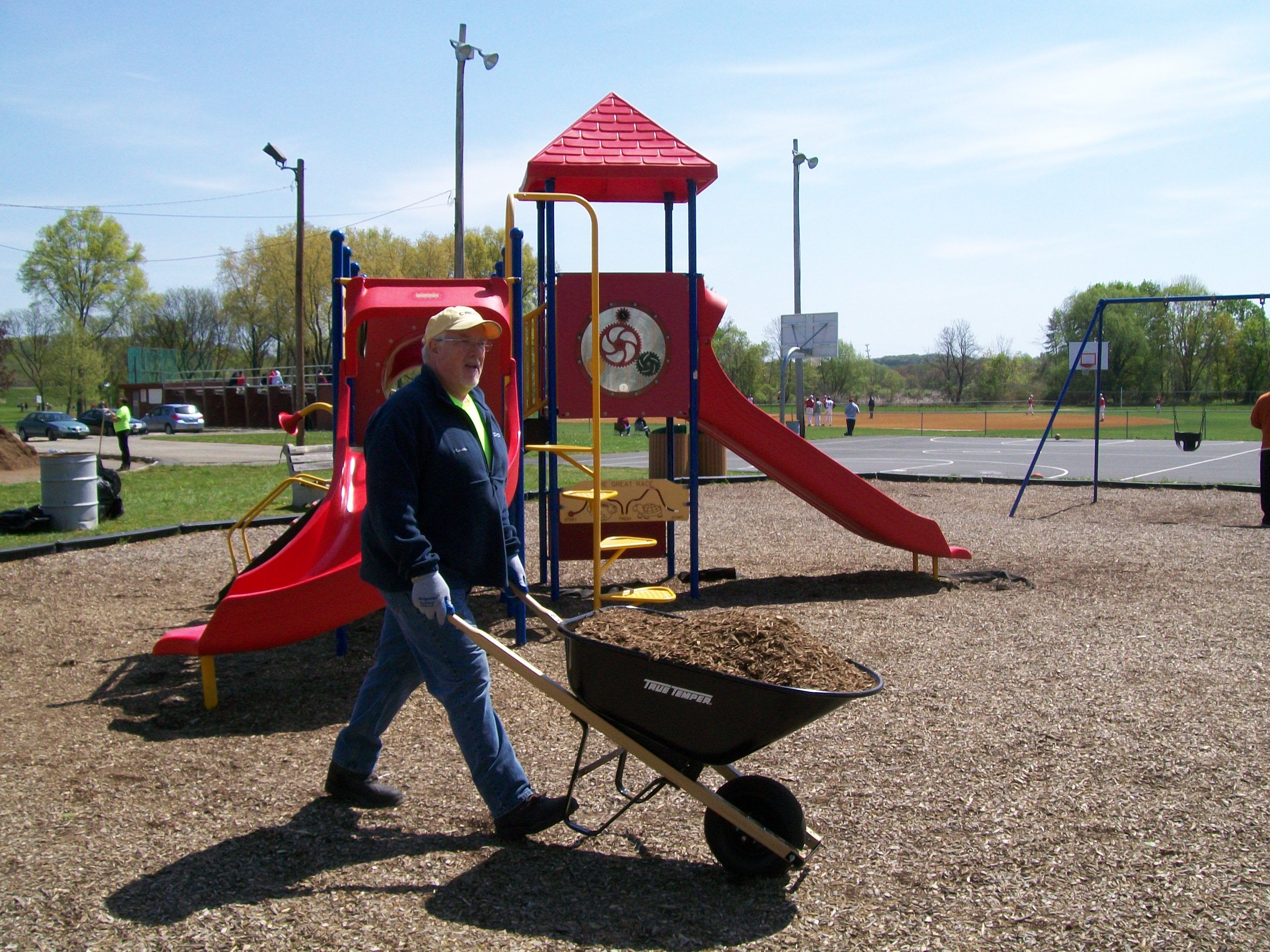 Spreading mulch at Memory Park