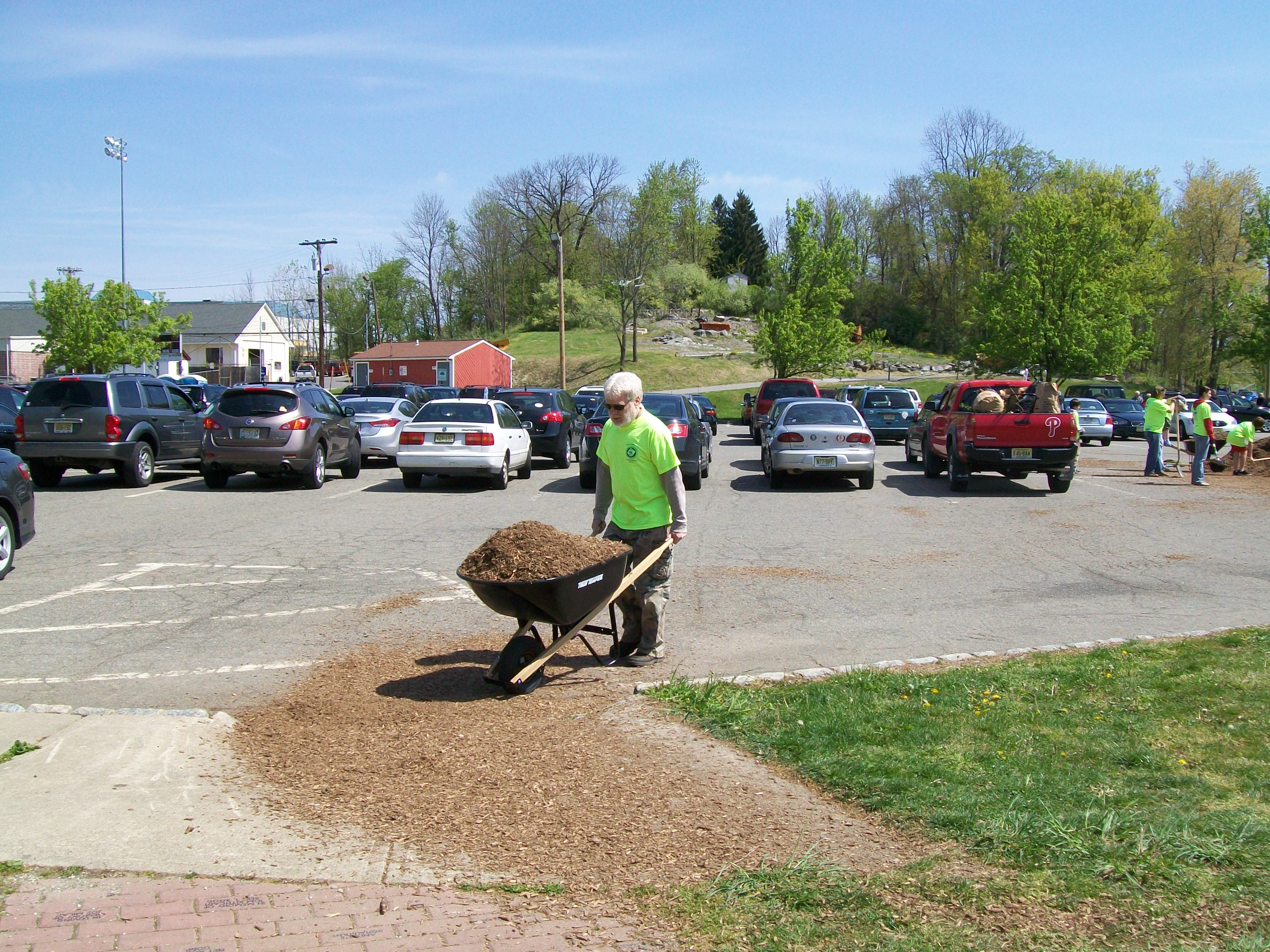 Memory Park - Spreading mulch on the playground